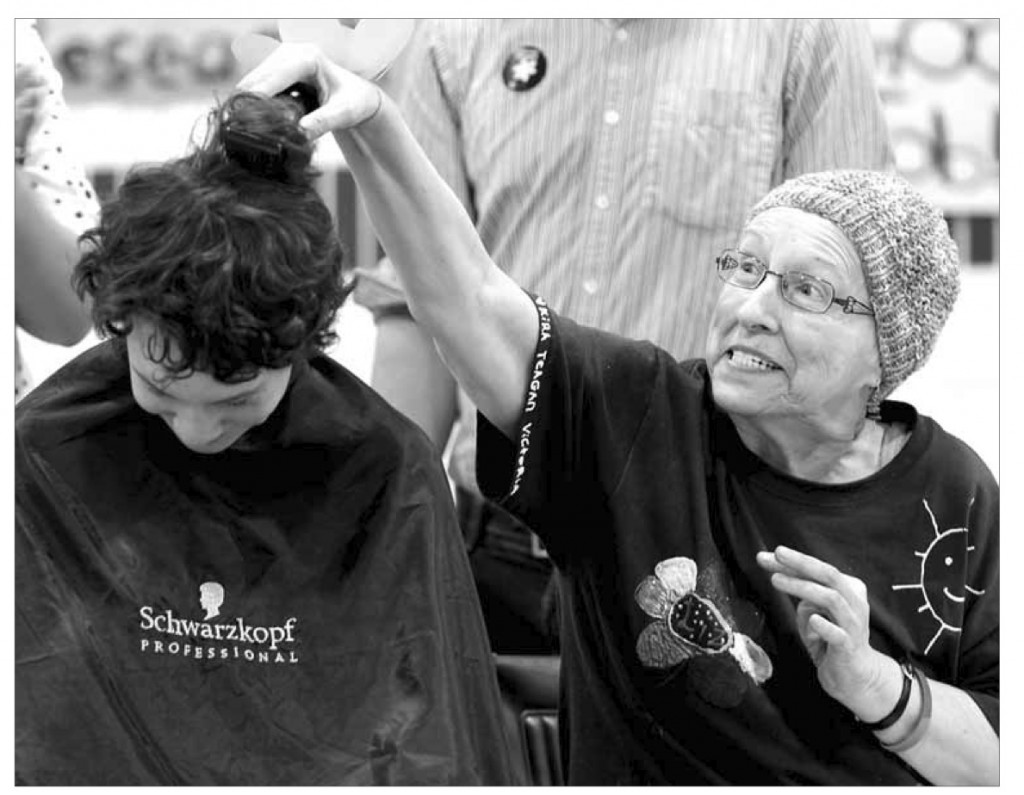Elizabeth Grant shaves the first strip of hair off Michael Wenham, 14 at the King George School fundraiser. Wenham raised over $ 10,000 towards the Canadian Cancer Society. c. 2013 Brandon Sun archives