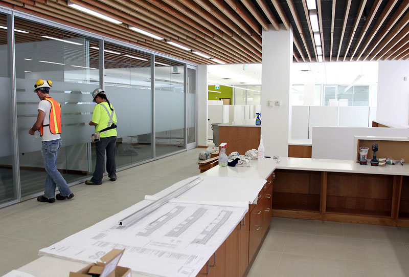 Workers continue to prep the new civic services complex. c. Brandon Sun. 2014