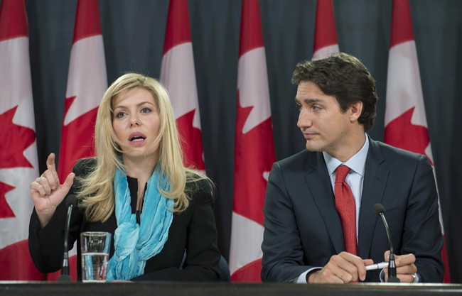 Former Conservative MP Eve Adams (left) is joined by Liberal Leader Justin Trudeau as she announces in Ottawa on Monday, Feb. 9, 2015 that she is leaving the Conservative Party to join the Liberal Party of Canada. THE CANADIAN PRESS/Justin Tang