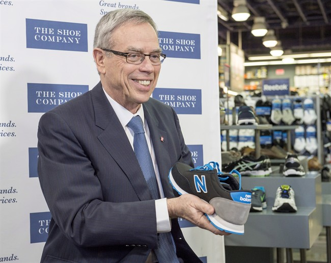 Finance Minister Joe Oliver shows off his new shoes to reporters. The longstanding tradition exists that the current Finance Minister purchases new shoes prior to delivering the upcoming budget. (Winnipeg Free Press)