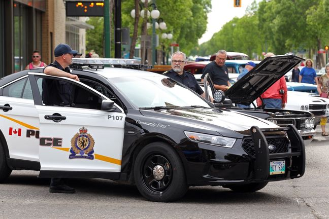 City of Brandon Police members speak with residents during a recent cruise nights event. c. 2015 Brandon Sun.
