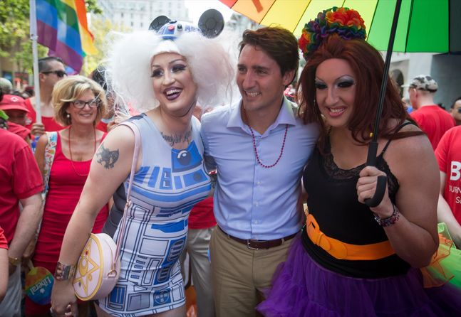 "Liberal Leader Justin Trudeau stands for a photo with revellers before marching in the Vancouver Pride Parade last weekend. Shaun Cameron writes that Trudeau's ""ground game"" may be able to mobilize the type of voters who felt disenfranchised in the past."