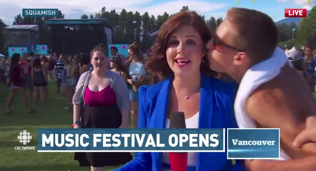 A man kisses CBC reporter Megan Batchelor while she was reporting live from the Squamish Valley Music Festival on Aug. 7. (YouTube)