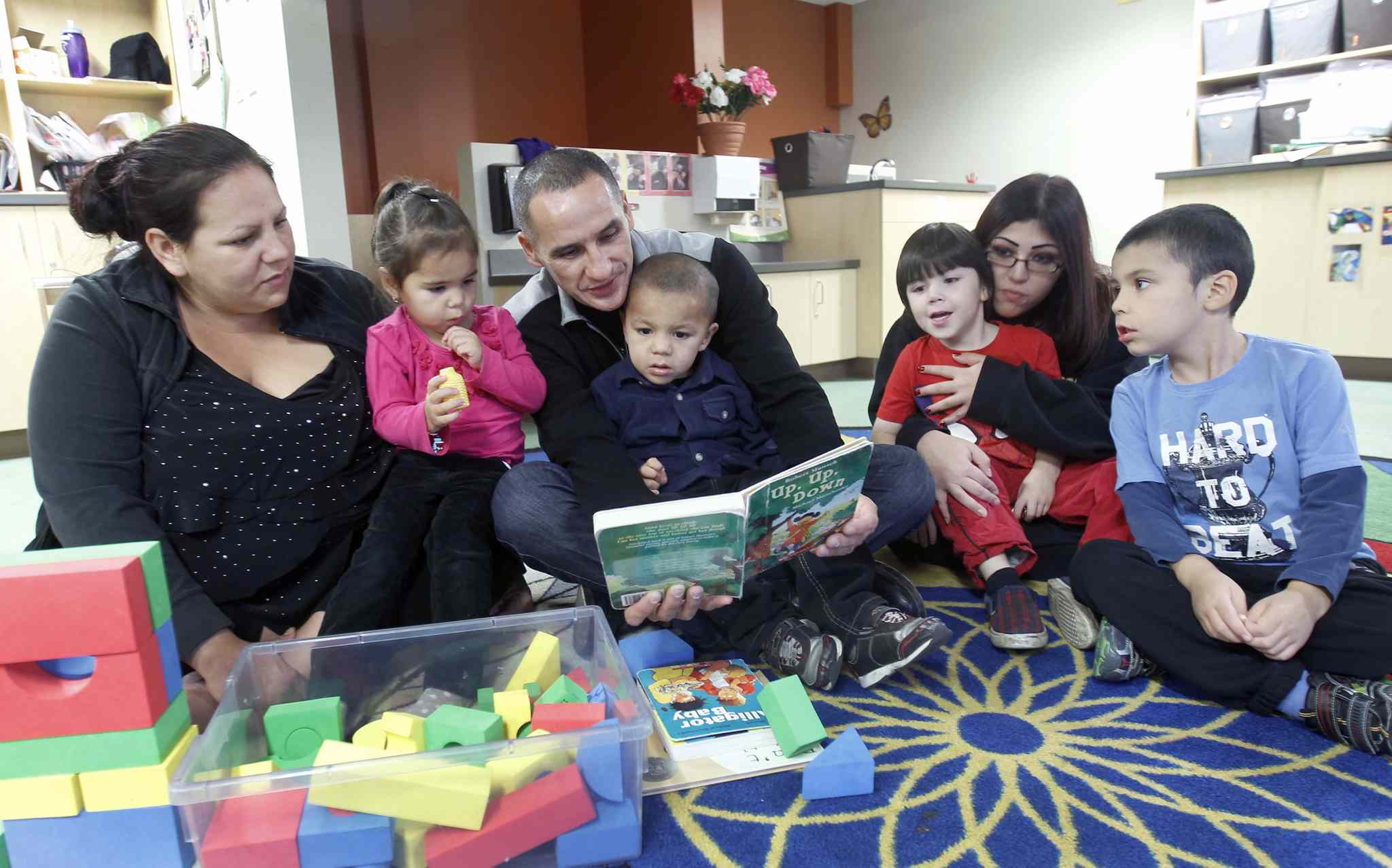 L to R- Jennifer Fincaryk, her daughter Kyrstyn Fleury, Minister of Children and Youth Opportunities Kevin Chief, Jennifers?s daughter ? Kelson Fleury, Mother Ashley Vivier, and her son Christopher Grant, and daughter Alexander Vivier at Lord Selkirk Childcare Centre- 102-269 Dufferin? See Carol Sanders story- Oct 03, 2014   (JOE BRYKSA / WINNIPEG FREE PRESS)