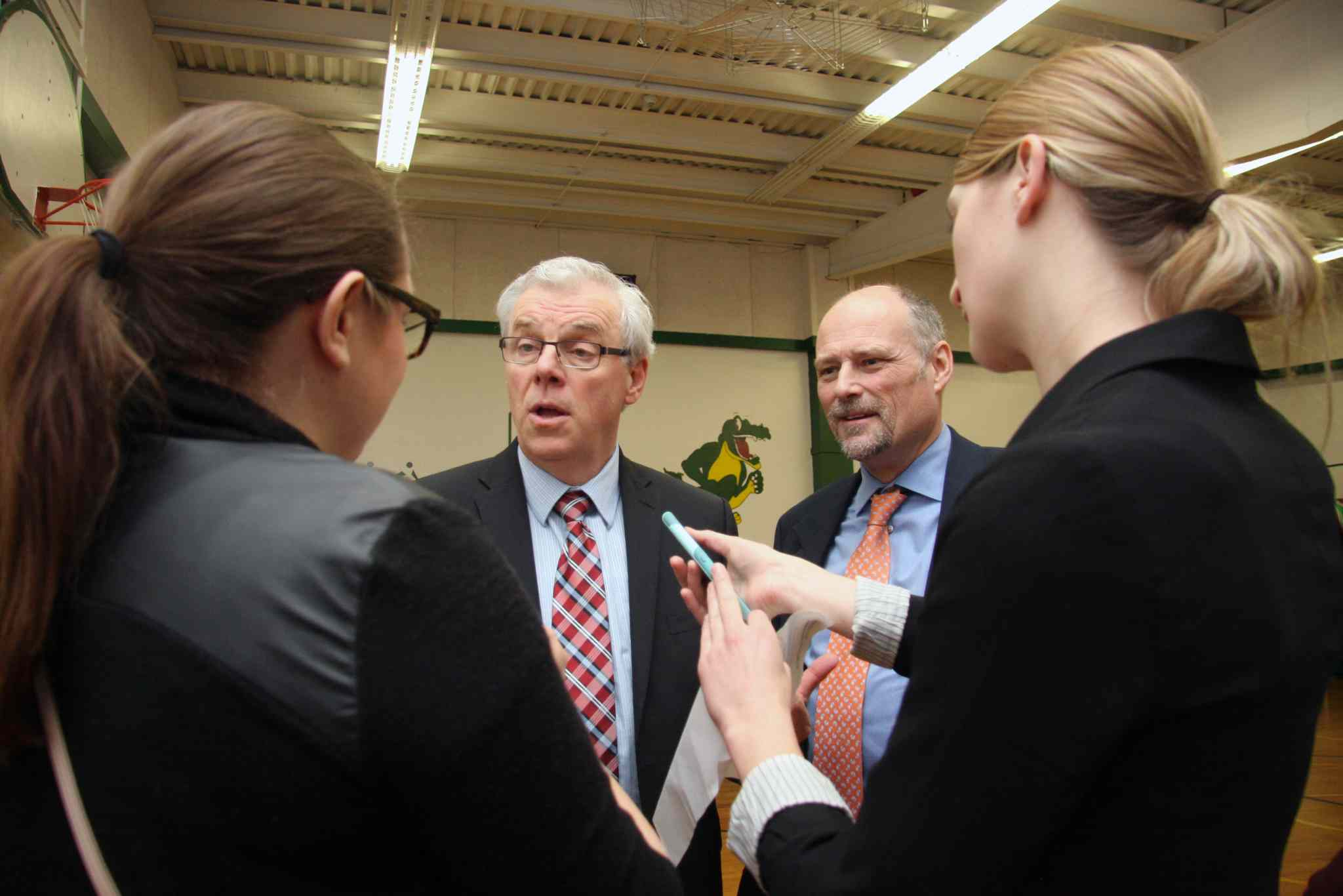 Brandon Sun Manitoba NDP Premier Greg Selinger and Brandon East MLA Drew Caldwell speak to reporters following the announcement of a new gymnasium for Green Acres school in the Brandon School Division. (Matt Goerzen/Brandon Sun-file)