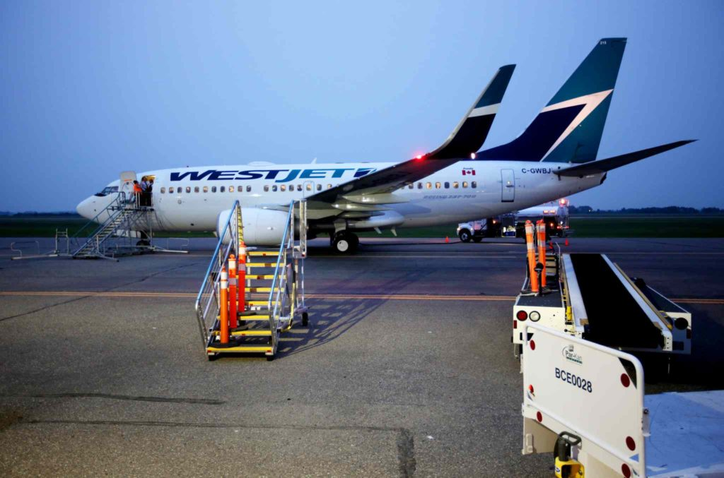 Brandon Sun 29062015 A Westjet Boeing 737 refuels at Brandon Municipal Airport at around 10:00PM after being diverted from Winnipeg on Monday evening during an incident at Winnipeg's James Armstrong Richardson International Airport. (Tim Smith/Brandon Sun)