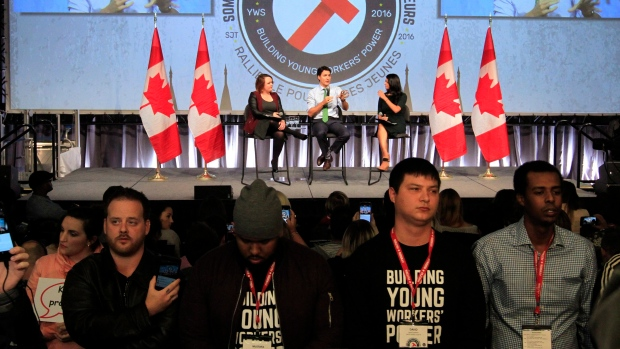Students turn their back on the Prime Minister at a recent youth event. (The Canadian Press- Brandon Sun)